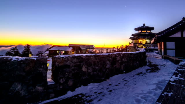 stockvideo's en b-roll-footage met sunrise at gazebo shaped observatory on snowy mt deogyusan - gazebo