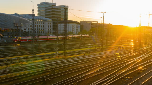 sunrise at hauptbahnhof train station, munich,germany - tramway stock videos & royalty-free footage