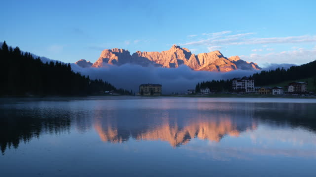 Sunrise at Lake Misurina and in background mountain group Sorapiss with the highest peak Punta Sorapiss (3205m).