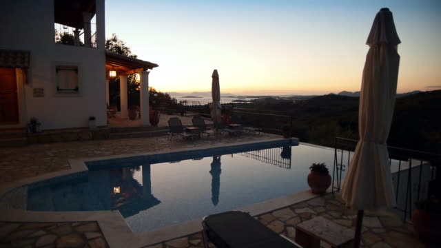 sunrise at large villa with sea view and infinity swimming pool - infinity pool stock videos & royalty-free footage
