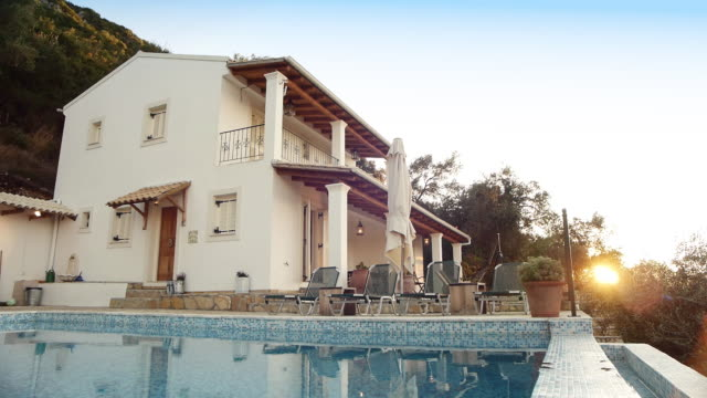 sunrise at large villa with swimming pool - holiday villa stock videos & royalty-free footage
