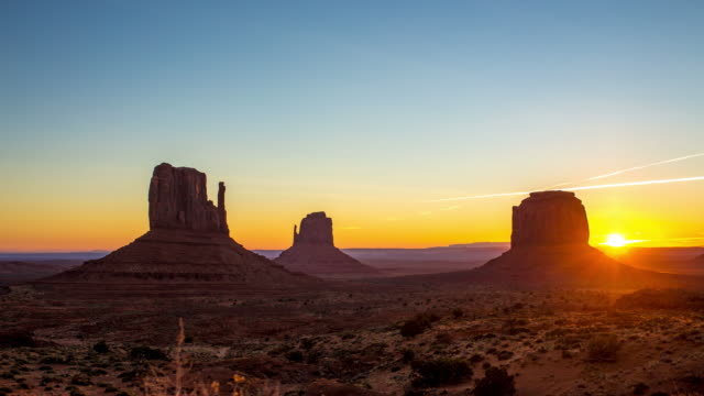 sunrise at monument valley - monument valley stock videos & royalty-free footage