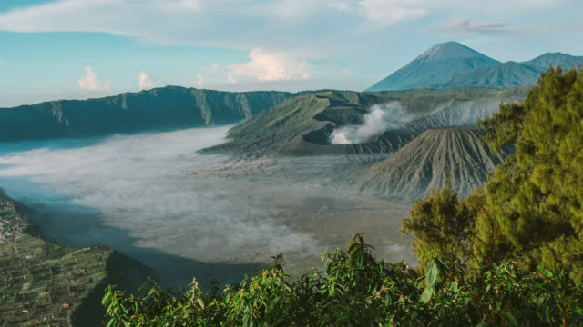 sunrise at mount bromo volcano, the magnificent view of mt. bromo located in bromo tengger semeru national park, east java, indonesia. zoom in camera - tengger stock videos & royalty-free footage