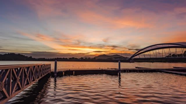 sunrise at putrajaya lake - putrajaya stock videos & royalty-free footage