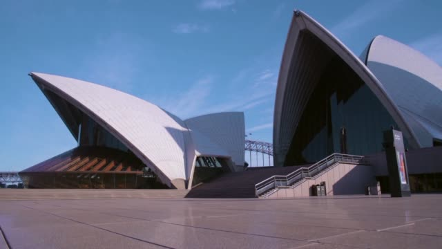 sunrise at the sydney opera house during covid-19 restrictions on saturday april 18, 2020. the iconic sydney opera house as the sun rises on the... - famous place点の映像素材/bロール