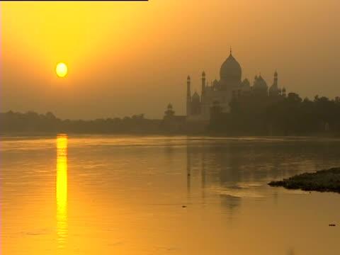 sunrise at the taj mahal - taj mahal stock videos and b-roll footage