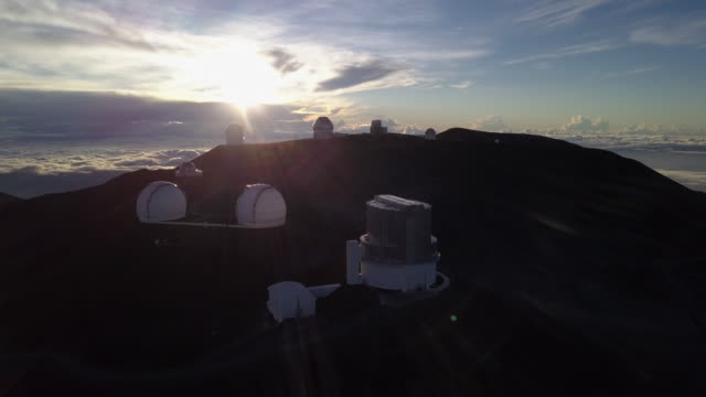 sunrise at the telescopes of mauna kea astronomical observatory, hawaii. usa - big island hawaii islands stock videos & royalty-free footage