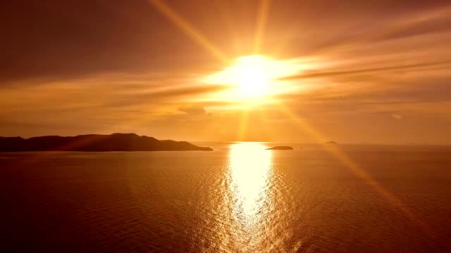 Sunrise behind clouds, aerial video