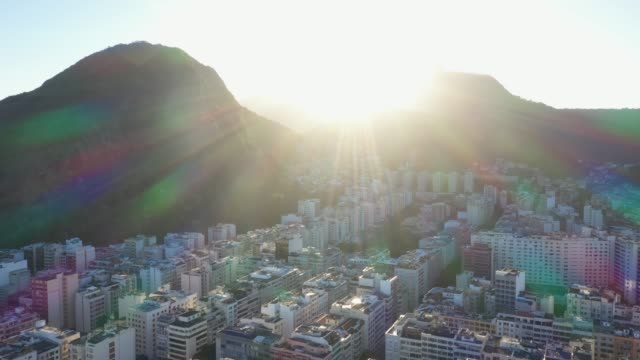 sunrise behind hills in rio de janeiro, copacabana - downtown district stock videos & royalty-free footage