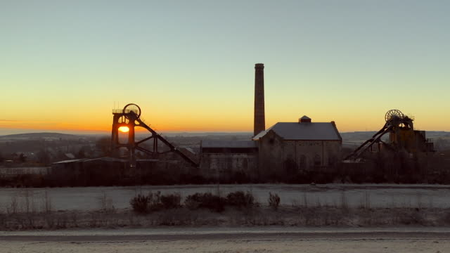 sunrise behind old coal mine on frosty winter morning in mansfield - coal mine stock videos & royalty-free footage