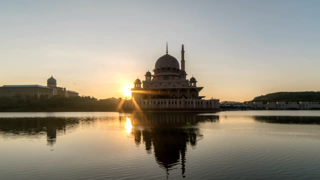 sunrise by the mosque. time lapse. zoom in - putrajaya stock videos & royalty-free footage