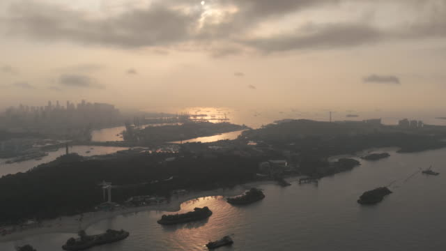 sunrise drone video of singapore commercial dock - harbour stock videos & royalty-free footage