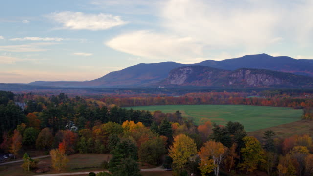 sunrise foliage in north conway new hampshire aerial shot. - new hampshire stock-videos und b-roll-filmmaterial