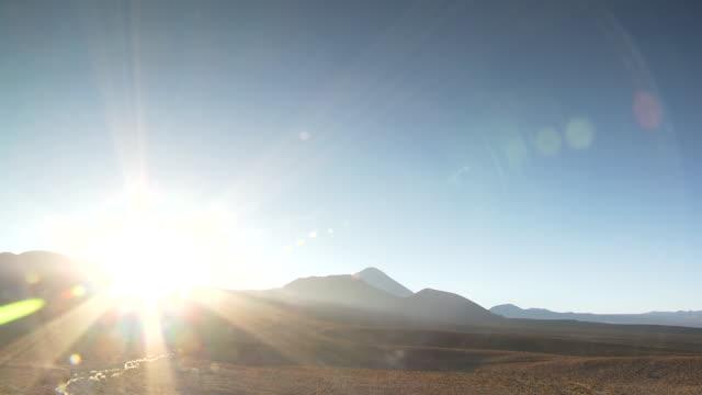 ws t/l sunrise from behind mountain / san pedro de atacama, norte grande, chile - san pedro de atacama stock videos & royalty-free footage