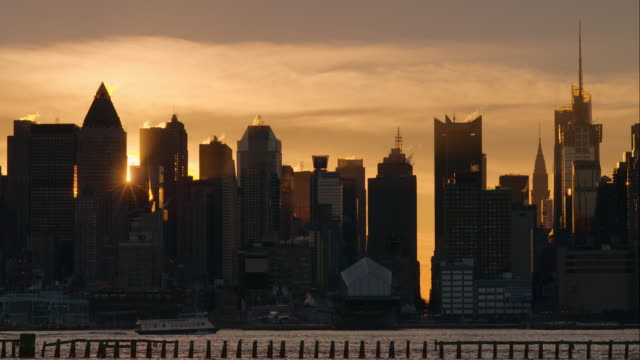 Sunrise From Behind the Manhattan Skyline