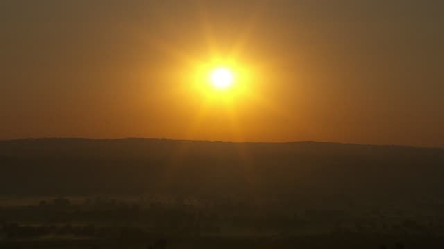 sunrise from glastonbury tor - horizon over land stock videos & royalty-free footage