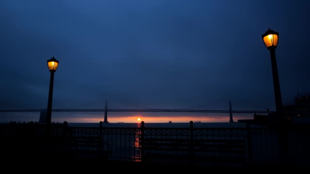 hd sunrise from the pier - electric lamp stock videos & royalty-free footage