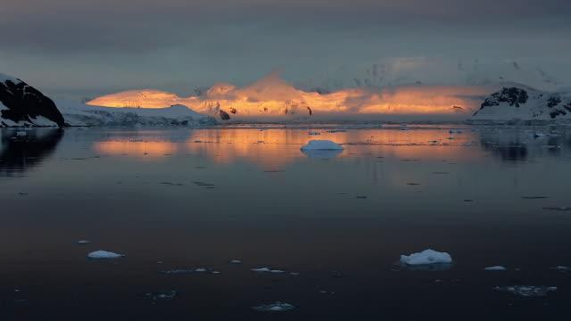 Sunrise in Antarctica, orange glaciers