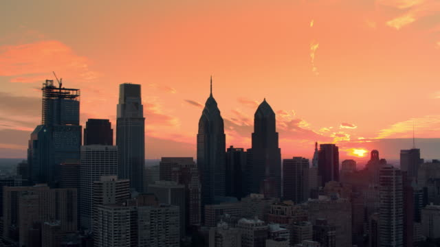 aerial sunrise in center city, philadelphia - center city philadelphia stock videos and b-roll footage