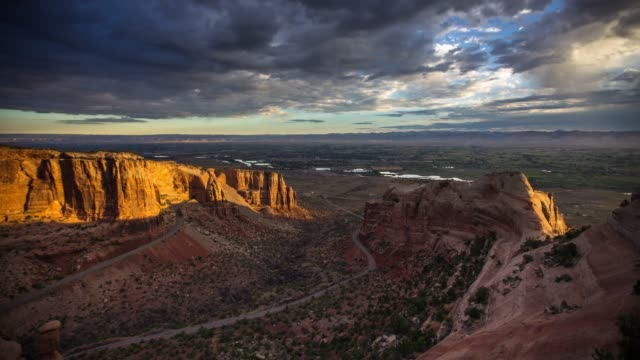 sunrise in colorado national monument - time lapse - red rocks stock videos & royalty-free footage