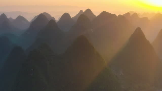 sunrise in karst peak forest - yangshuo stock videos & royalty-free footage