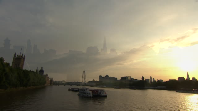 sunrise in london and commuter going to work on the day boris johnson becomes the uk's new prime minister - sunrise dawn stock videos & royalty-free footage