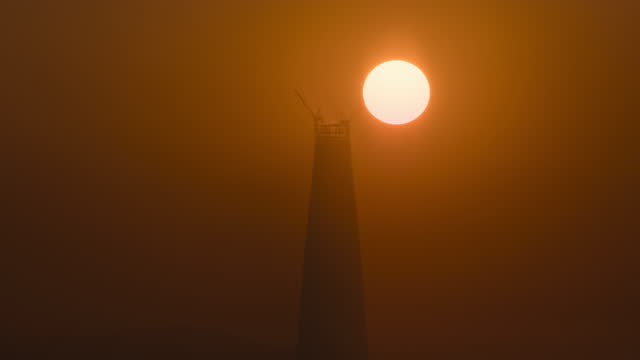 sunrise in lotte world tower under construction at jamsil district / songpa-gu, seoul, south korea - construction industry stock videos & royalty-free footage