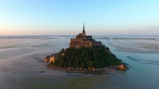 sunrise in mont saint-michel, aerial view by drone - normandy stock videos & royalty-free footage