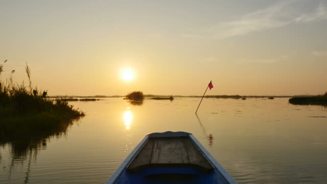 Sunrise in Morning on boat trip at pink lotus lake, Udon Thani Province, Thailand.
