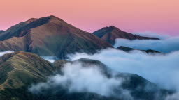 Sunrise in mountains nature above clouds in New Zealand landscape Time lapse