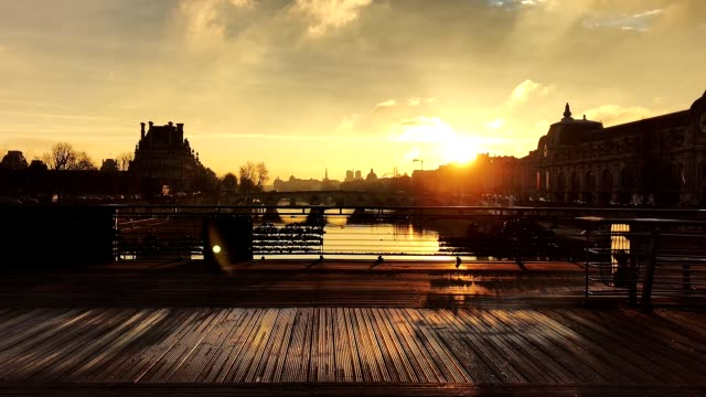 sunrise in paris view from a bridge with at right the musée d'orsay - river seine stock videos & royalty-free footage