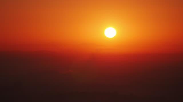 sunrise in pyongyang, north korea, dprk. shot from yanggakdo hotel - spoonfilm stock videos and b-roll footage