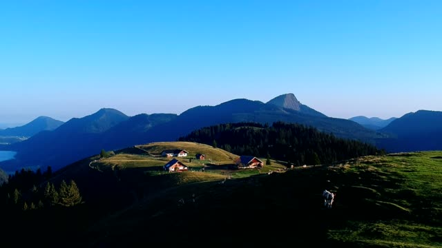 sunrise in the austrian alps in summer - hut stock videos & royalty-free footage