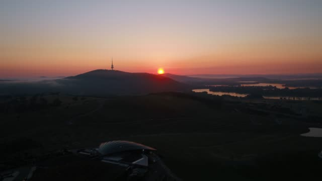 sunrise in the canberra hills with drone - moody sky stock videos & royalty-free footage