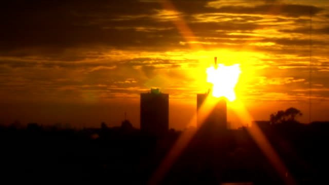 Sunrise in the city with clouds timelapse