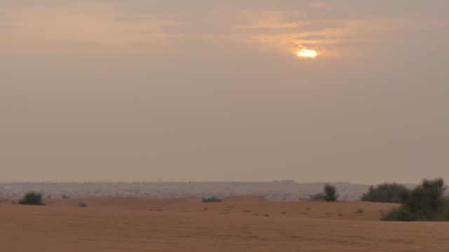 Sunrise in the desert on Desert Safari near Dubai, Dubai, United Arab Emirates, Middle East, Asia