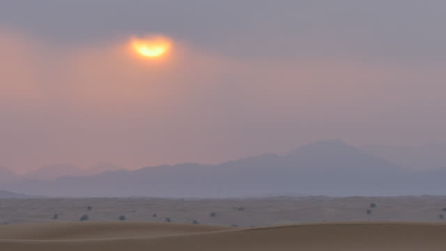 Sunrise in the desert on Desert Safari near Dubai, Dubai, United Arab Emirates, Middle East, Asia