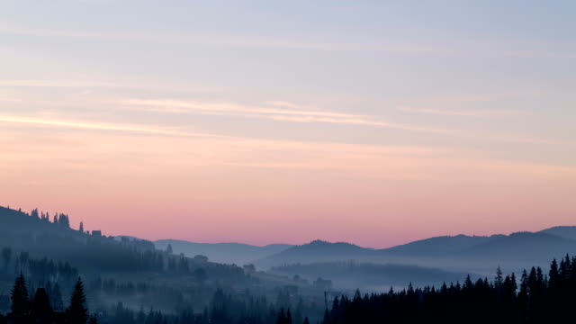 Sunrise in the mountains with fog in the valley.