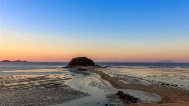 sunrise landscape of mokseom(natural landmark) in seonjaedo island at low tide - natural landmark stock videos & royalty-free footage