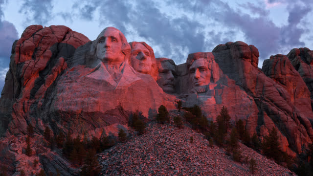 t/l sunrise light at mount rushmore national monument in the black hills / keystone, south dakota, usa - monument stock videos & royalty-free footage