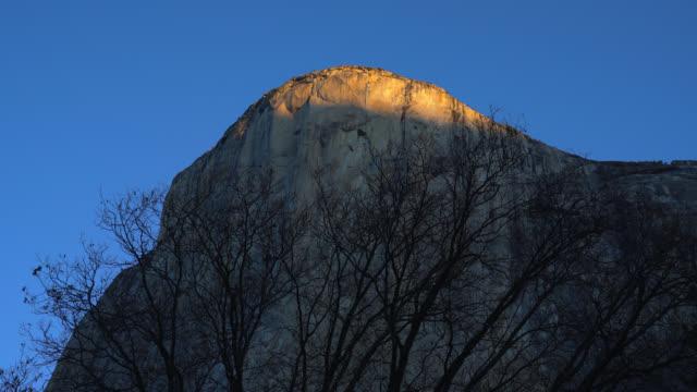 sunrise light on el capitan - el capitan yosemite national park stock videos and b-roll footage