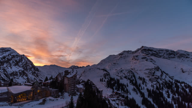tl sunrise of buildings in france at portes du soleil - stazione sciistica video stock e b–roll