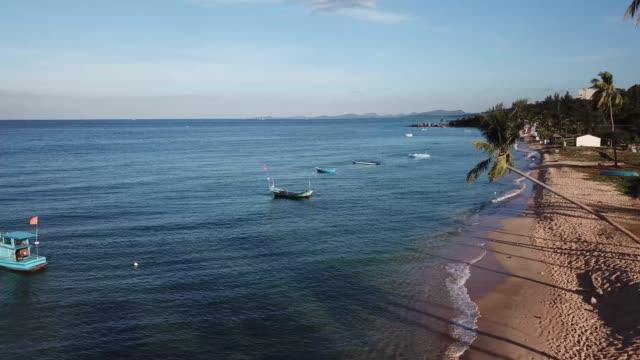 sunrise on deep blue sea and white sand beach of phu quoc island, vietnam - vietnam meridionale video stock e b–roll