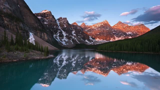ws t/l sunrise on moraine lake and the valley of the ten peaks - valley of the ten peaks stock videos and b-roll footage