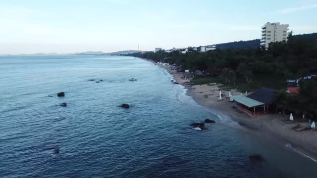sunrise on pristine white sand beach of phu quoc island, vietnam - vietnam meridionale video stock e b–roll