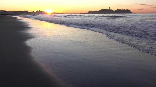 Sunrise on the beach with Enoshima. Time lapse