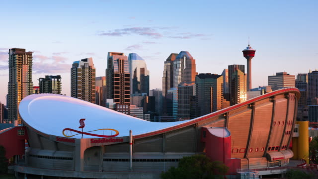 t/l sunrise on the calgary skyline with the saddledome and calgary tower - tower stock videos & royalty-free footage