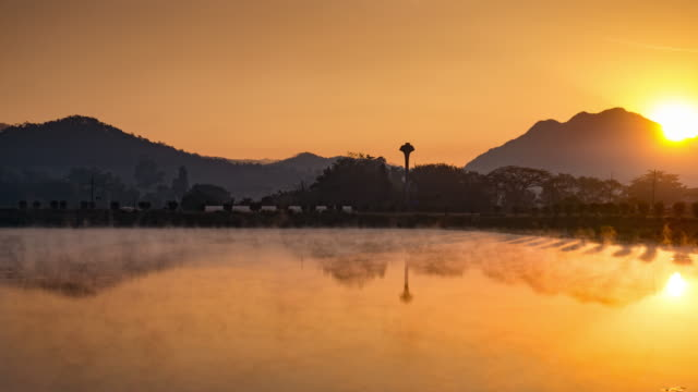 Sunrise on the lake reflection and mist on the lake , 4k (UHD) , Time-lapse