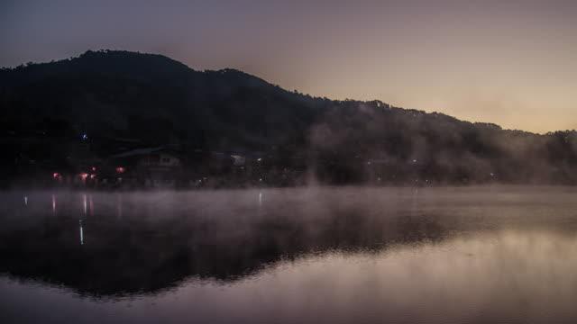 Sunrise on the lake reflection and mist on the lake , 4k (UHD)