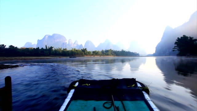 sunrise on the li river - boat point of view stock videos & royalty-free footage